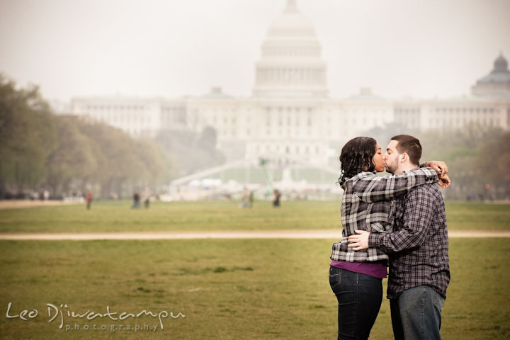 Engaged couple kissing by the Capitol building. Pre wedding engagement photo session the Mall, National Monument, The Capitol, Washington DC by wedding photographer Leo Dj Photography