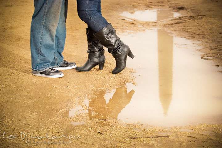 Engaged couple shoes by a reflection of the National Monument on a water. Pre wedding engagement photo session the Mall, National Monument, The Capitol, Washington DC by wedding photographer Leo Dj Photography