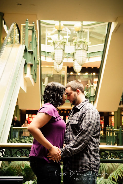 Engaged girl cuddling with her fiancé. Pre wedding engagement photo session at Georgetown, Washington DC by wedding photographer Leo Dj Photography