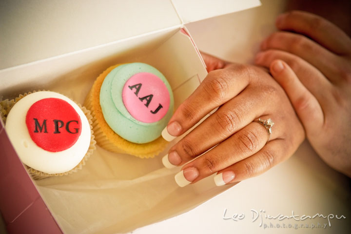 Engaged girl showing her engagement ring by custom made cupcakes by Georgetown Cupcakes. Pre wedding engagement photo session at Georgetown, Washington DC by wedding photographer Leo Dj Photography