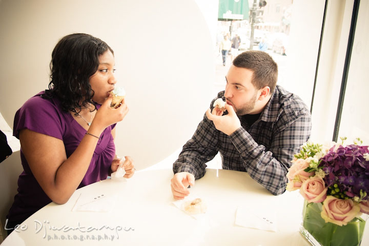 Engaged guy and girl eating cupcakes. Pre wedding engagement photo session at Georgetown, Washington DC by wedding photographer Leo Dj Photography