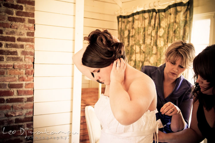 bride putting dress with mother and maid of honor. Clifton Inn Charlottesville VA Destination Wedding Photographer