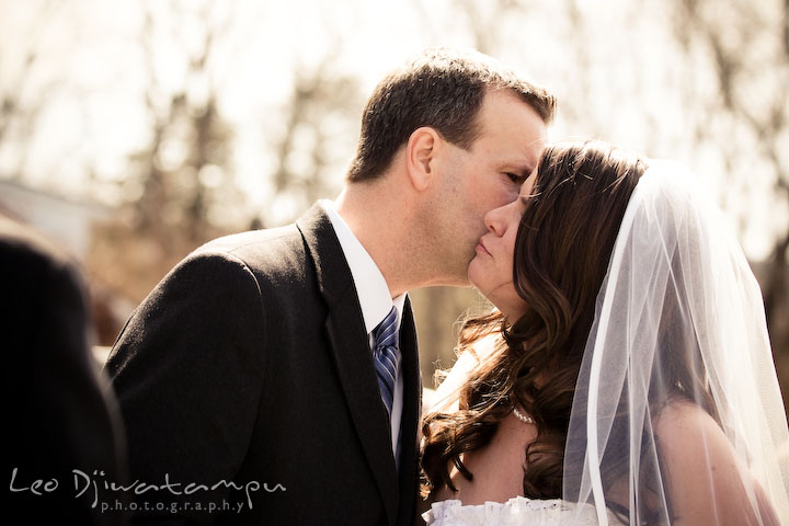 father of the bride kissed daughter, letting her go. Clifton Inn Charlottesville VA Destination Wedding Photographer