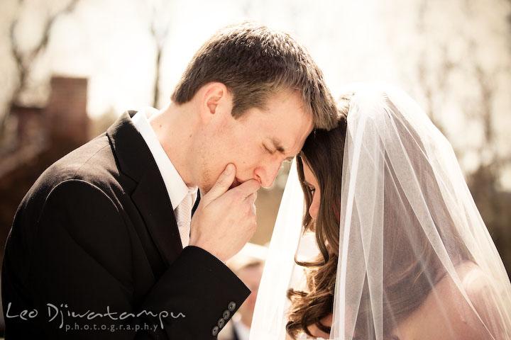 groom and bride having an emotional moment, praying together. Clifton Inn Charlottesville VA Destination Wedding Photographer