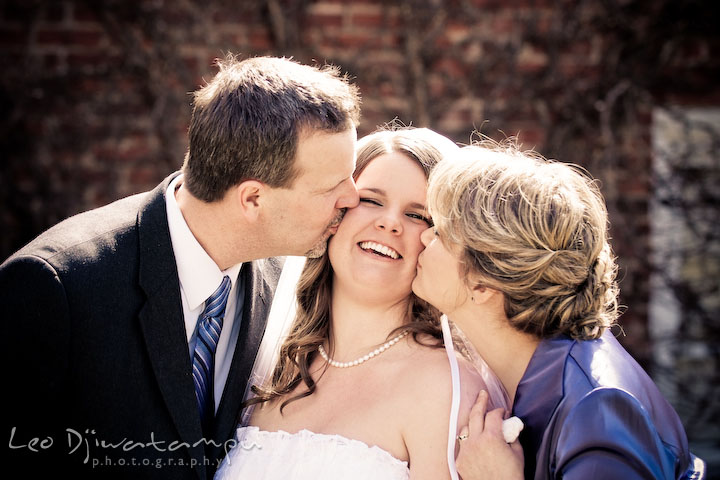 bride gets kiss from her parents, father and mother. Clifton Inn Charlottesville VA Destination Wedding Photographer