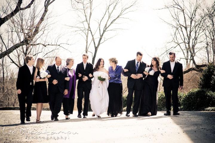 Bride, groom, maid of honor, bridesmaid, best man, groomsman, and parents walking together. Clifton Inn Charlottesville VA Destination Wedding Photographer