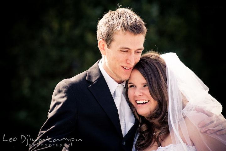 bride and groom cuddling, laughing together. Clifton Inn Charlottesville VA Destination Wedding Photographer