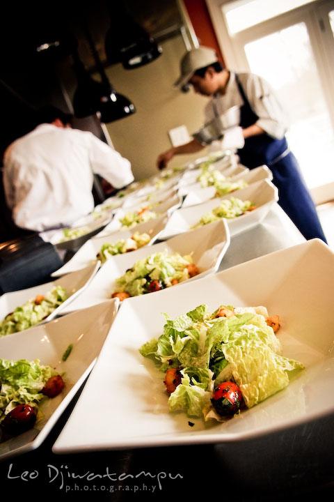 chef and kitchen staff preparing food, salad for the wedding party. Clifton Inn Charlottesville VA Destination Wedding Photographer