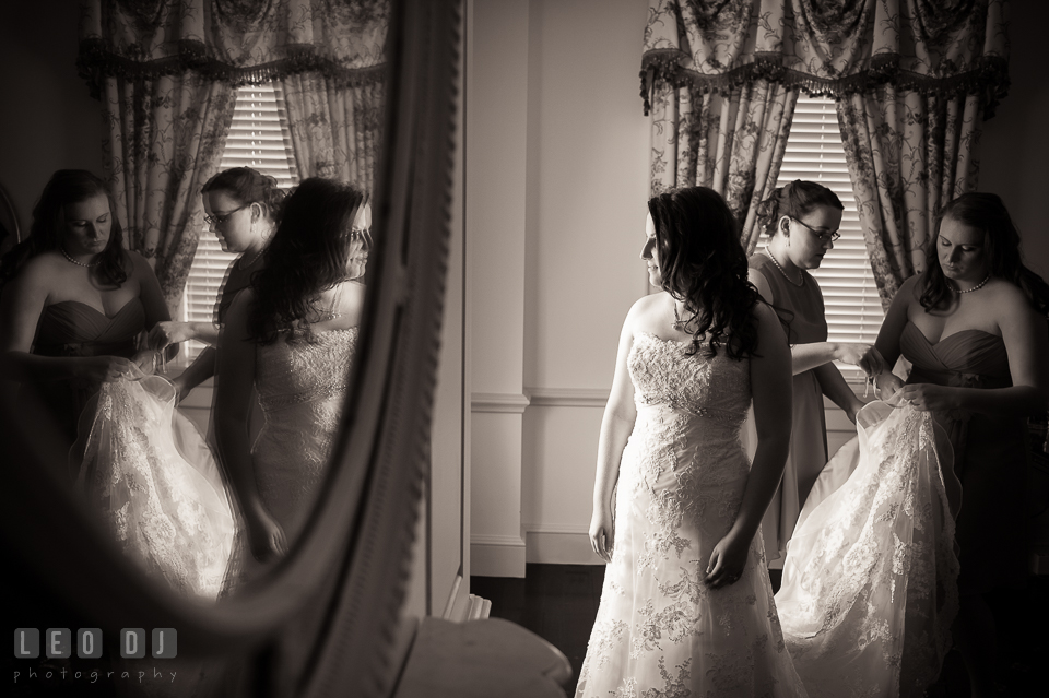 The Bride looking at her reflection in the mirror. Aspen Wye River Conference Centers wedding at Queenstown Maryland, by wedding photographers of Leo Dj Photography. http://leodjphoto.com