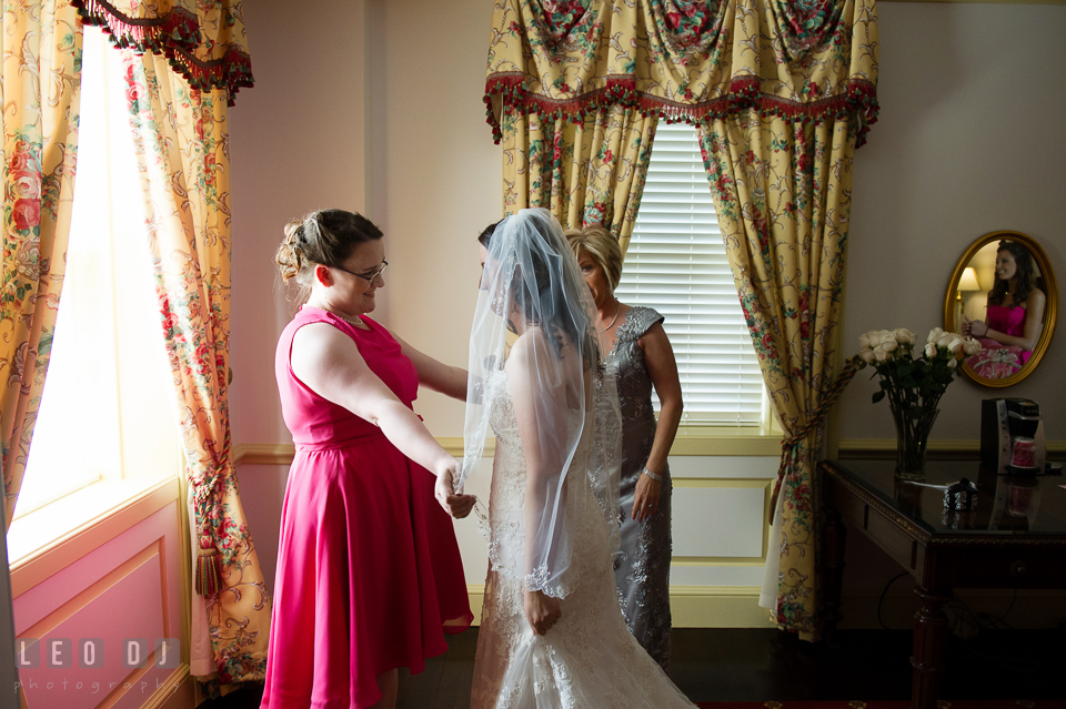 The Bride embraced by her sister. Aspen Wye River Conference Centers wedding at Queenstown Maryland, by wedding photographers of Leo Dj Photography. http://leodjphoto.com