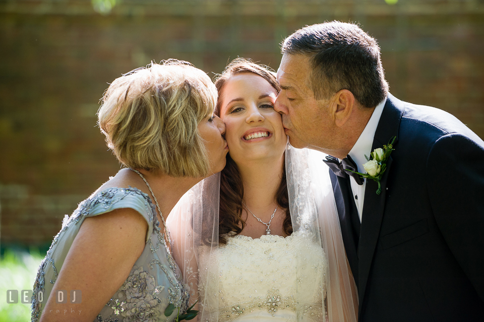 A kiss for the Bride from her proud parents. Aspen Wye River Conference Centers wedding at Queenstown Maryland, by wedding photographers of Leo Dj Photography. http://leodjphoto.com