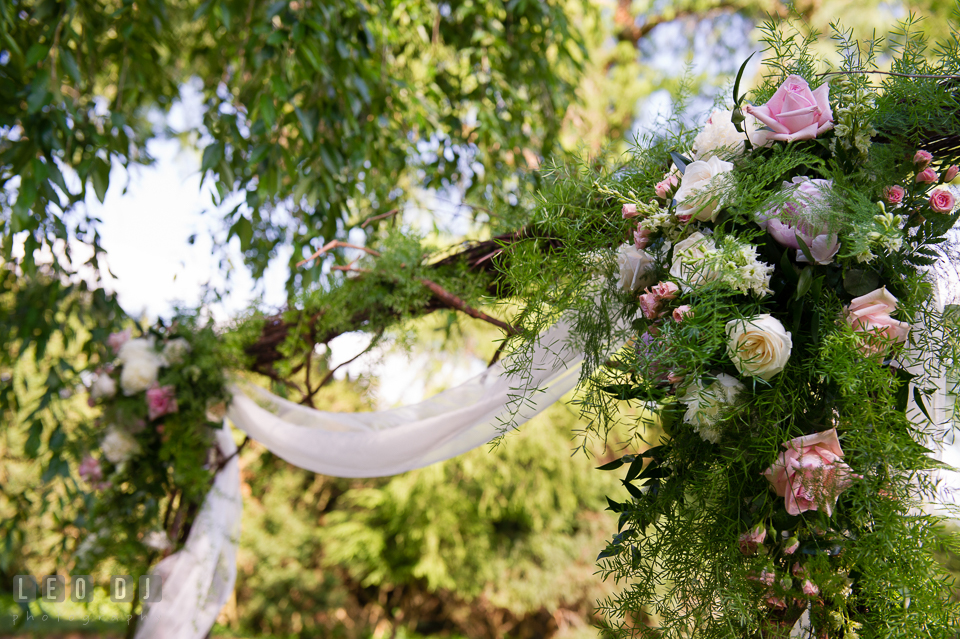 Beautiful arch with pastel colored roses by Monteray Farms florist. Aspen Wye River Conference Centers wedding at Queenstown Maryland, by wedding photographers of Leo Dj Photography. http://leodjphoto.com