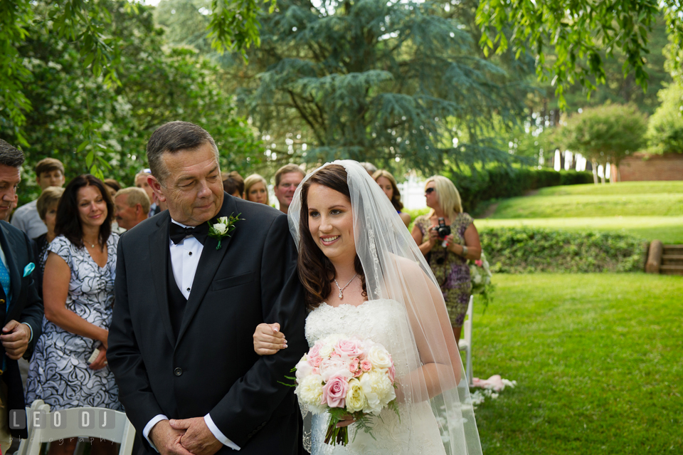 The Bride with her father walking down the aisle. Aspen Wye River Conference Centers wedding at Queenstown Maryland, by wedding photographers of Leo Dj Photography. http://leodjphoto.com