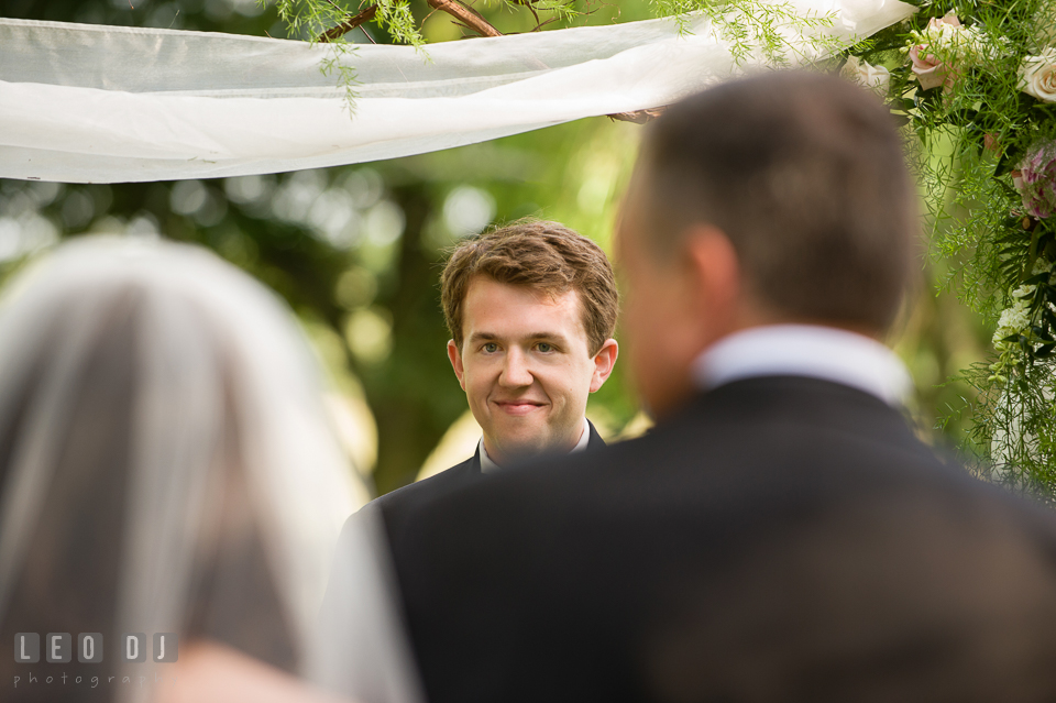 The Groom eyeing his beautiful Bride as she approaches. Aspen Wye River Conference Centers wedding at Queenstown Maryland, by wedding photographers of Leo Dj Photography. http://leodjphoto.com