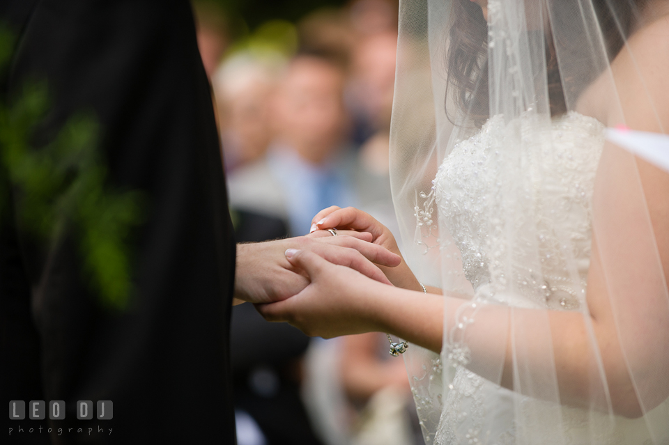 Exchanging wedding bands during the ceremony. Aspen Wye River Conference Centers wedding at Queenstown Maryland, by wedding photographers of Leo Dj Photography. http://leodjphoto.com