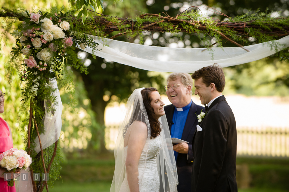 Bride and Groom laughing during ceremony vow. Aspen Wye River Conference Centers wedding at Queenstown Maryland, by wedding photographers of Leo Dj Photography. http://leodjphoto.com