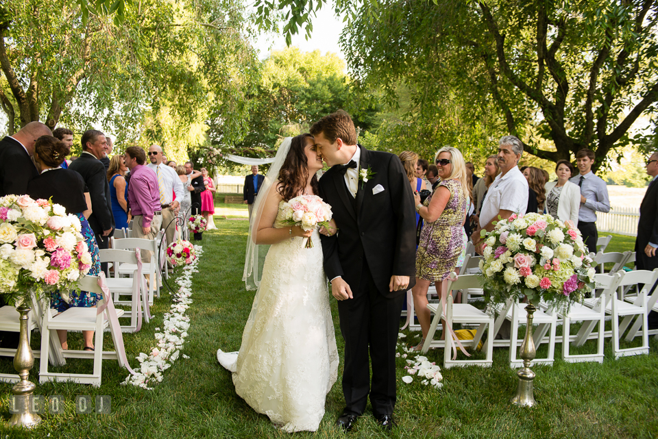 The Bride and Groom kissing during recessional after their wedding ceremony. Aspen Wye River Conference Centers wedding at Queenstown Maryland, by wedding photographers of Leo Dj Photography. http://leodjphoto.com
