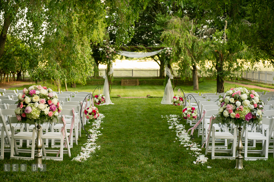 The beautiful setting for wedding ceremony with flower decors from florist Monteray Farms. Aspen Wye River Conference Centers wedding at Queenstown Maryland, by wedding photographers of Leo Dj Photography. http://leodjphoto.com