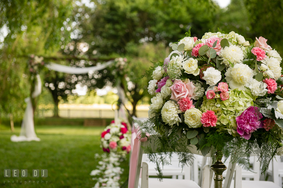 Gorgeous arrays of flower decors and floral petals adorned for the wedding ceremony by Monteray Farms. Aspen Wye River Conference Centers wedding at Queenstown Maryland, by wedding photographers of Leo Dj Photography. http://leodjphoto.com