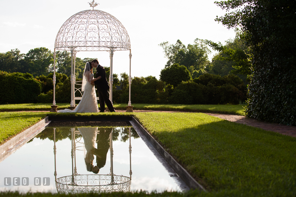 The Bride and Groom kissing under the gazebo. Aspen Wye River Conference Centers wedding at Queenstown Maryland, by wedding photographers of Leo Dj Photography. http://leodjphoto.com