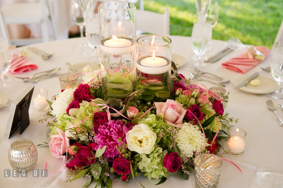 Magnificent table centerpieces of candles and colorful blooms by Monteray Farms. Aspen Wye River Conference Centers wedding at Queenstown Maryland, by wedding photographers of Leo Dj Photography. http://leodjphoto.com