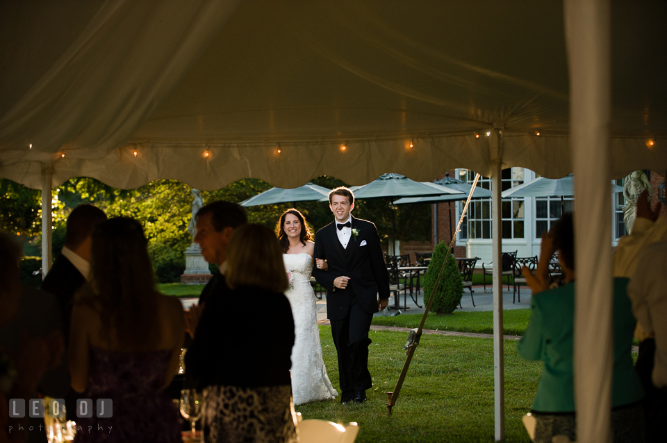The Bride and Groom entered the wedding reception tent during introduction by DJ Steve Moody. Aspen Wye River Conference Centers wedding at Queenstown Maryland, by wedding photographers of Leo Dj Photography. http://leodjphoto.com