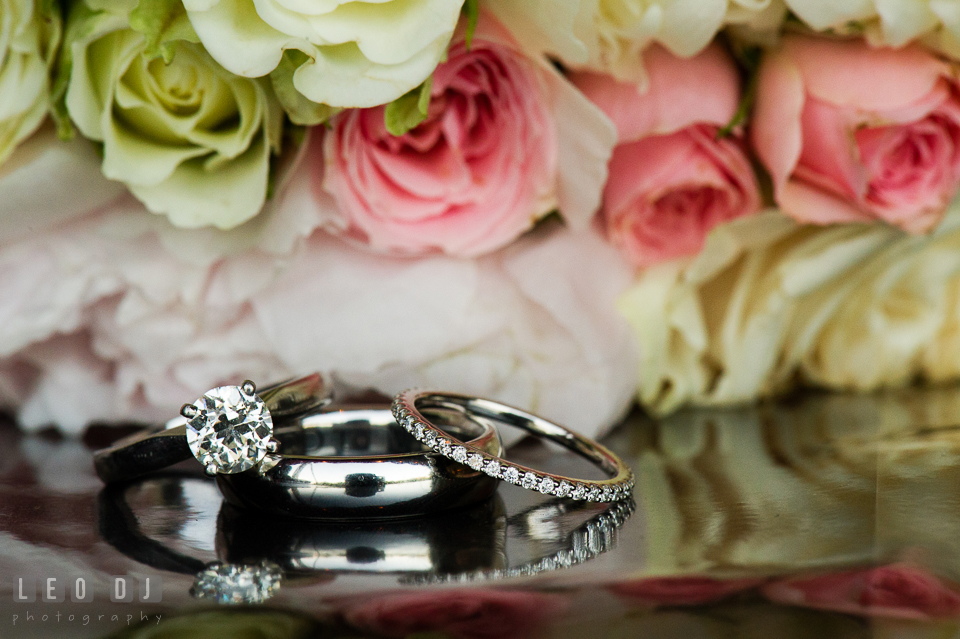 Close up shot of wedding bands and diamond engagement ring. Aspen Wye River Conference Centers wedding at Queenstown Maryland, by wedding photographers of Leo Dj Photography. http://leodjphoto.com