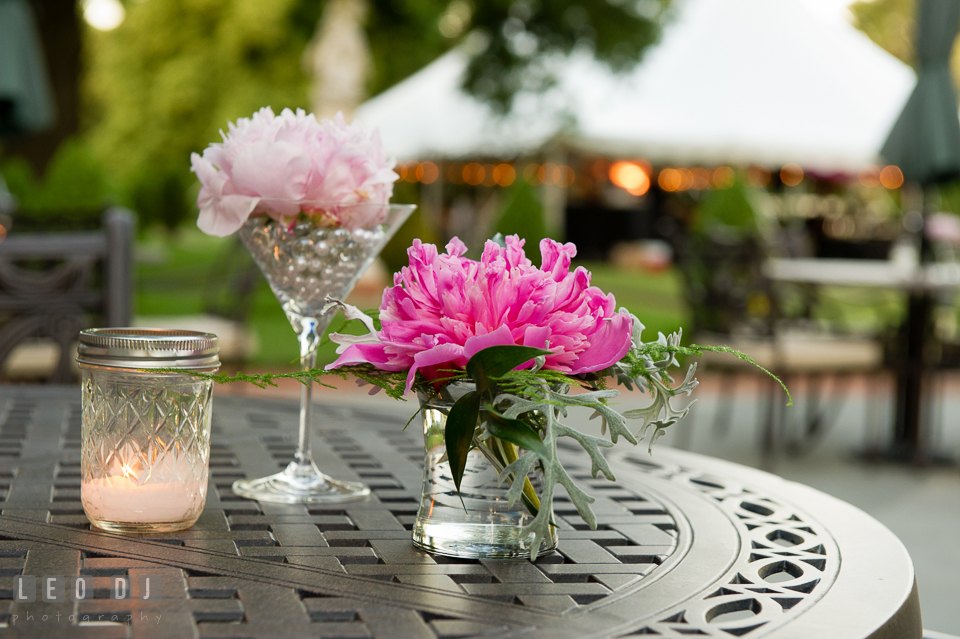 Candle and flowers for table decor during cocktail hour. Aspen Wye River Conference Centers wedding at Queenstown Maryland, by wedding photographers of Leo Dj Photography. http://leodjphoto.com