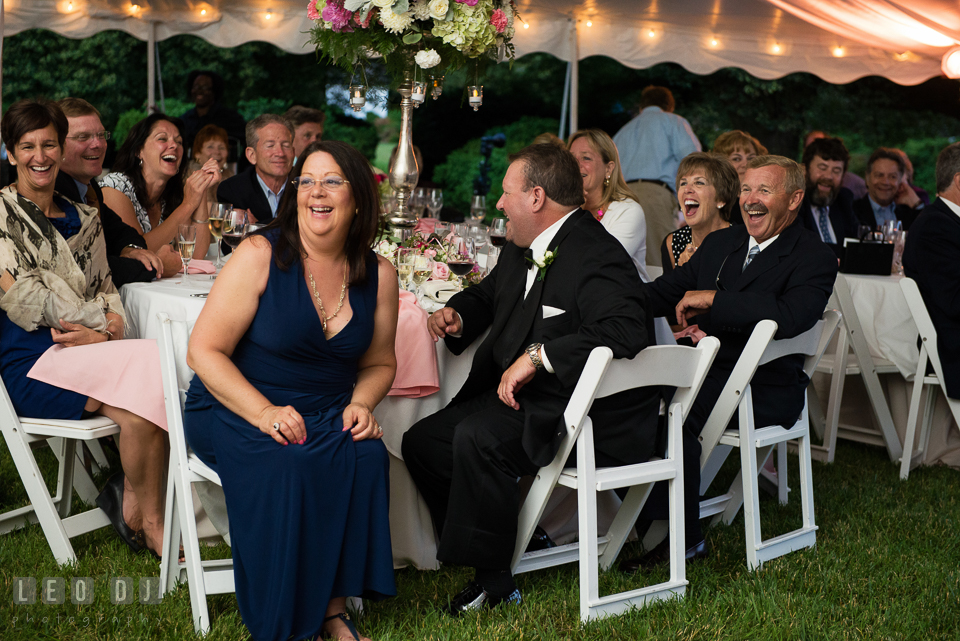 Mother, Father of Groom and guests laughing during toast speech. Aspen Wye River Conference Centers wedding at Queenstown Maryland, by wedding photographers of Leo Dj Photography. http://leodjphoto.com