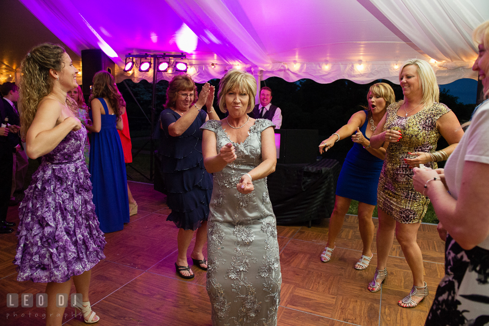 Mother of the Bride silly dancing at the wedding reception. Aspen Wye River Conference Centers wedding at Queenstown Maryland, by wedding photographers of Leo Dj Photography. http://leodjphoto.com