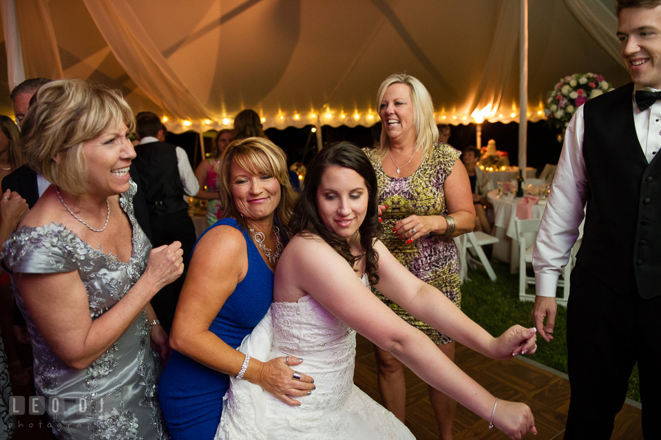The Bride dancing with guests at the wedding reception. Aspen Wye River Conference Centers wedding at Queenstown Maryland, by wedding photographers of Leo Dj Photography. http://leodjphoto.com