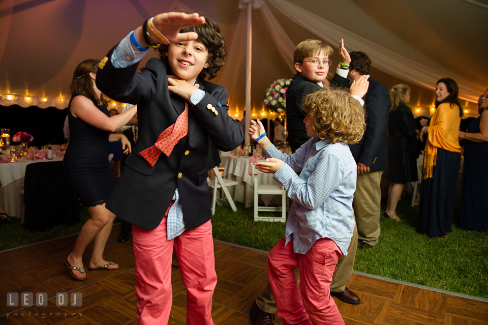 Partying kids dancing at the wedding reception. Aspen Wye River Conference Centers wedding at Queenstown Maryland, by wedding photographers of Leo Dj Photography. http://leodjphoto.com