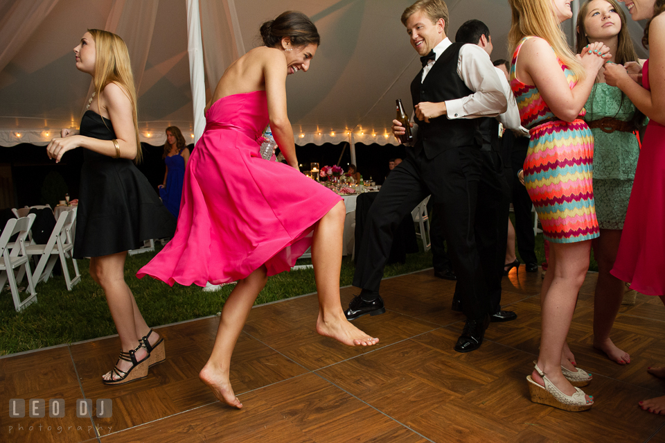 Best man and bridesmaid dancing dancing and jumping during the wedding reception. Aspen Wye River Conference Centers wedding at Queenstown Maryland, by wedding photographers of Leo Dj Photography. http://leodjphoto.com