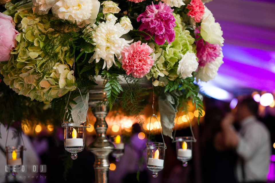 Hanging candles among the flower arrangements. Aspen Wye River Conference Centers wedding at Queenstown Maryland, by wedding photographers of Leo Dj Photography. http://leodjphoto.com