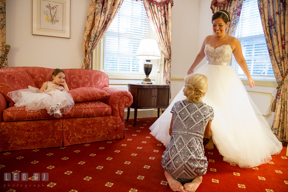 Aspen Wye River Conference Centers Mother of Bride helping daughter get dressed photo by Leo Dj Photography
