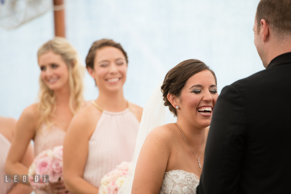 Aspen Wye River Conference Centers Bride laughing and in tears while reciting vows during ceremony photo by Leo Dj Photography