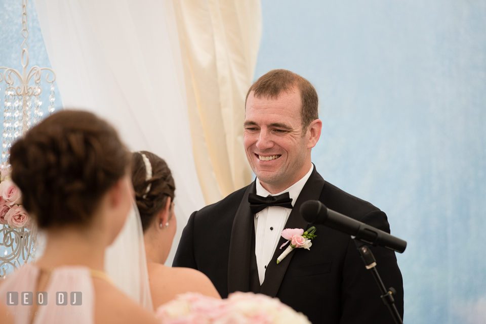 Queenstown Maryland Wedding Groom smiling during vow photo by Leo Dj Photography