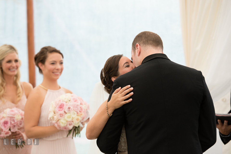 Eastern Shore Maryland Wedding Bride and Groom first kiss during ceremony photo by Leo Dj Photography