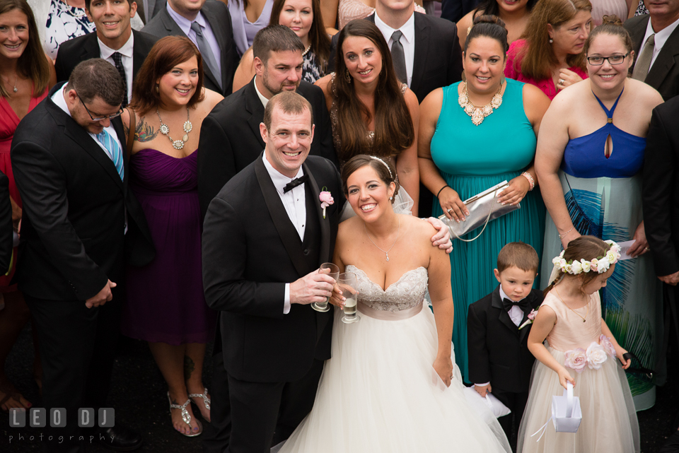 Queenstown Maryland Wedding Bride Groom smiling while posing with guests photo by Leo Dj Photography