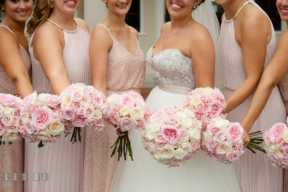 Aspen Wye River Conference Centers Bride, maid of honor, and bridesmaids showing rose bouquet by Intrigue Design and Decor photo by Leo Dj Photography