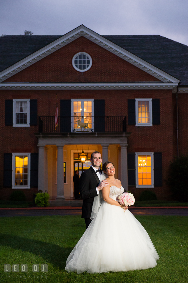 Aspen Wye River Conference Centers Bride and Groom posing in front of Houghton House photo by Leo Dj Photography