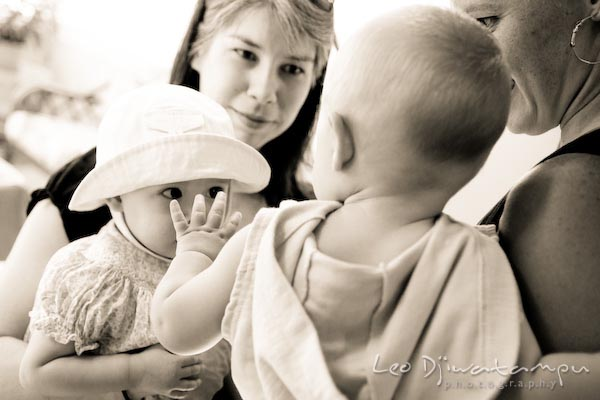 boy waving to girl with hat. baby toddler children candid photography annapolis kent island eastern shore maryland