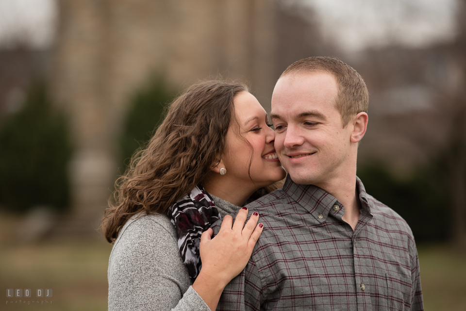 Baker Park Frederick Maryland engaged girl smile and kiss fiancé photo by Leo Dj Photography.