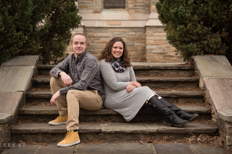 Baker Park Frederick Maryland engaged couple posing by bell tower photo by Leo Dj Photography.
