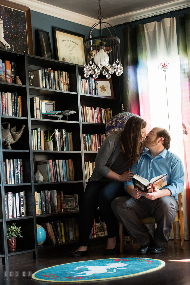 Home Residence Baltimore Maryland engaged girl almost kissed fiancé in library photo by Leo Dj Photography.