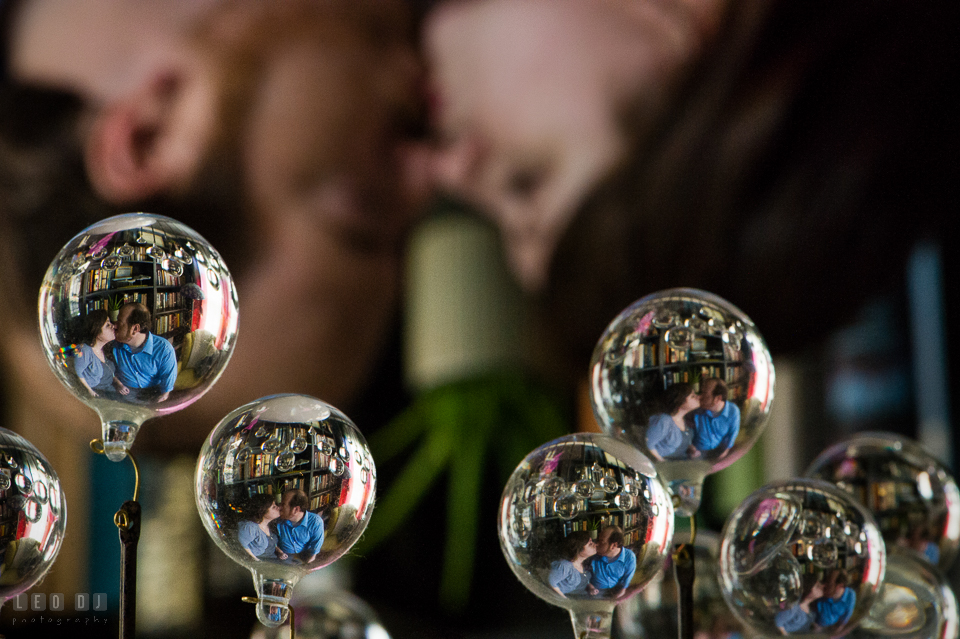 Home Residence Baltimore Maryland reflection of engaged couple almost kissing in bulbs photo by Leo Dj Photography.