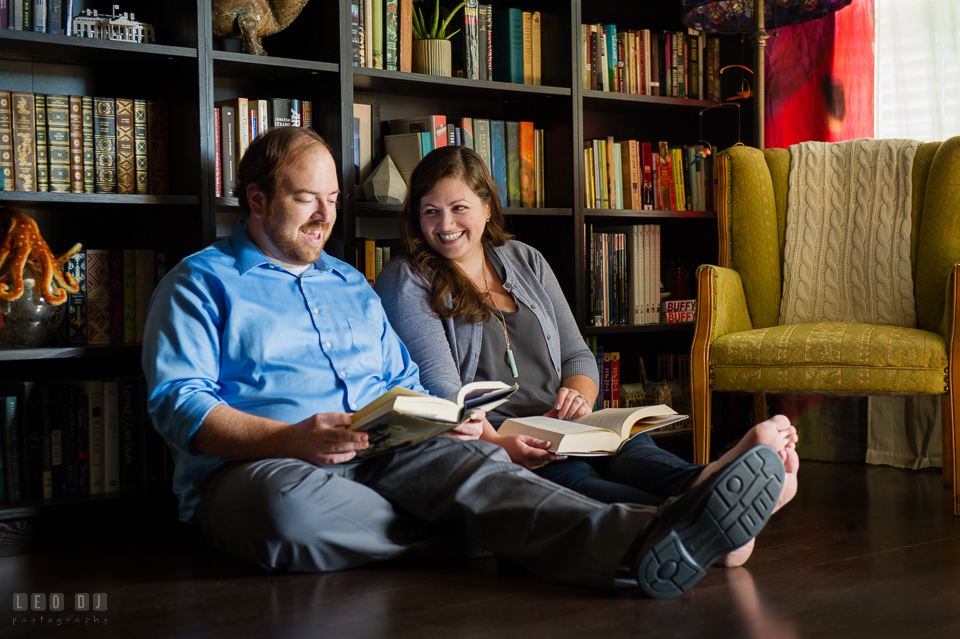 Condo Residence Baltimore Maryland engaged couple reading together in library photo by Leo Dj Photography.