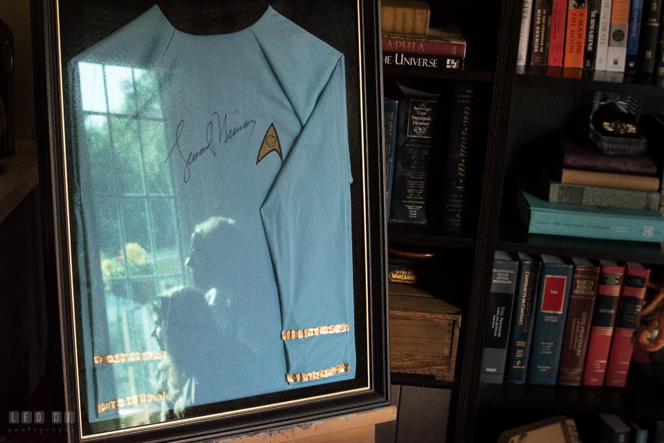 Home Residence Baltimore Maryland engaged couple reflection on Leonard Nimoy signed Star Trek uniform photo by Leo Dj Photography.