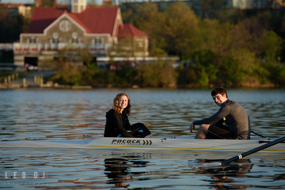 Baltimore Rowing Club Maryland boat house engaged man in boat with fiancee photo by Leo Dj Photography.