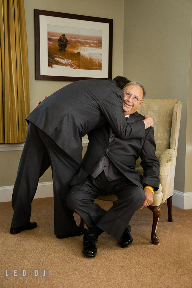 Groom hugging his Father during getting ready. The Tidewater Inn wedding, Easton, Eastern Shore, Maryland, by wedding photographers of Leo Dj Photography. http://leodjphoto.com